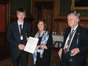 Matthew receiving his prize from Baroness D'Souza, with Lord Cormack