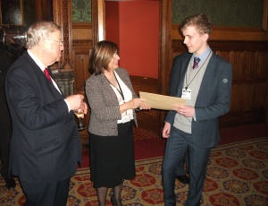 Alan receiving his prize from Baroness D'Souza, with Lord Cormack