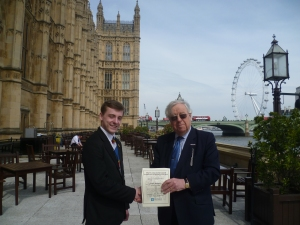 Josh receiving his prize from Lord Cormack